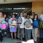 'r kids Family Center receives over 70 backpacks for kids in need